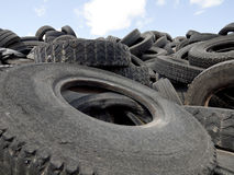 Recycling tires. Old used tires in a scrap yard waiting for recycling Royalty Free Stock Photo