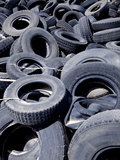 Recycling tires. Old used tires in a scrap yard waiting for recycling stock photography