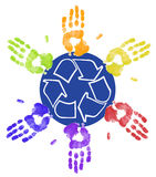 Recycling together. Many different colored hands working to recycle together Stock Images
