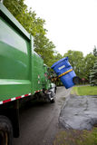 Recycling truck picking up bin - Vertical Stock Images