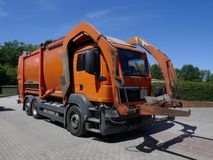 Recycling vehicle, truck, a heavy commercial vehicle at work. Recycling vehicle at work, truck, a heavy commercial vehicle royalty free stock images