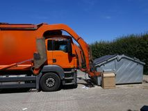 Recycling vehicle, truck, a heavy commercial vehicle at work. Recycling vehicle at work, truck, a heavy commercial vehicle stock image