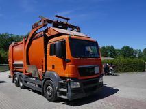 Recycling vehicle, truck, a heavy commercial vehicle at work. Recycling vehicle at work, truck, a heavy commercial vehicle stock photo
