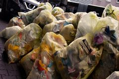 Garbage in plastic bags sorted and ready for transport. Recycling of waste, garbage problem. Garbage in plastic bags sorted and ready for transport royalty free stock images