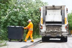 Recycling waste and garbage. Worker of municipal recycling garbage collector truck loading waste and trash bin Royalty Free Stock Images