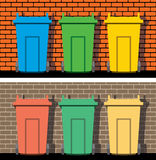 Recycling wheelie bins against the brick wall, vector  Royalty Free Stock Photography