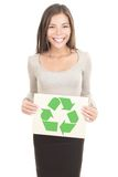 Recycling woman. Woman smiling showing the green recycle sign. Beautiful mixed chinese asian / caucasian businesswoman. Isolated on white background Stock Photo