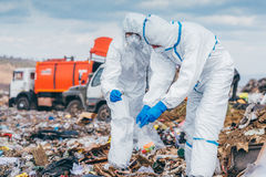 Recycling workers researching on the landfill Royalty Free Stock Photo