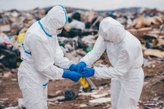 Recycling workers researching on the landfill Royalty Free Stock Images