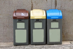 Recyling bins in Hong Kong. Three different colors imply different usage Royalty Free Stock Photos