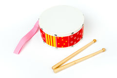 Red – yellow drum with drum sticks isolated on white background. Musical instrument, Drum toy for kids. Top, side view,. Drum toy for kids. Side view Stock Image