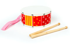 Red – yellow drum with drum sticks isolated on white background. Musical instrument,. Drum toy for kids. Side view Royalty Free Stock Images