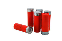 Red 12 Gage Shotgun shells. Six red 12 gage (GA) shotgun shells royalty free stock photography