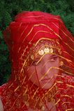 Red. Ethnic village girl wearing Middle Eastern clothing Royalty Free Stock Images