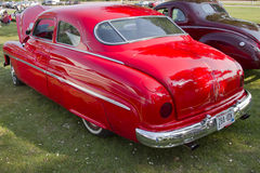 Red 1950 Merc. MARION, WI - SEPTEMBER 16: Red 1950 Merc Coupe car at the 3rd Annual Not Just Another Car Show on September 16, 2012 in Marion, Wisconsin Royalty Free Stock Photo