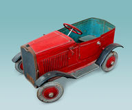 Red 1950 vintage toy car. Real toy car from 1950 with clipping path Stock Photo