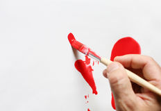 Red. Painting with bright red color Royalty Free Stock Photos