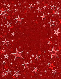 Red 3-D Stars. Embossed star shapes and star-field on a red paper background Stock Image