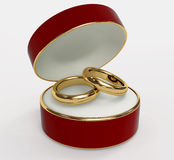 Red 3d casket with two wedding rings Royalty Free Stock Photo
