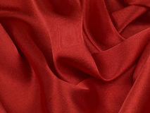 Red ablaze  satin background Stock Photos