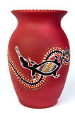 Red aboriginal vase. Depicting a platypus. Photographer is principal copyright owner Stock Photos