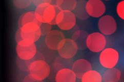 Red  abstract background with bokeh lights Stock Photos
