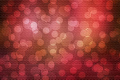 Red abstract bokeh. Abstract red background with blurred center spotlight bokeh. The picture has highlighted the texture of canvas Stock Images