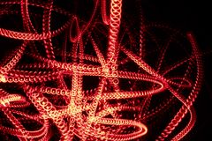 Red abstract light effect. Background. Long exposure photograph of moving lights royalty free stock image