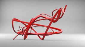 Red abstract swirls and ribbons - in a studio. Environment Royalty Free Stock Photography