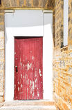 Red Accent Door: Limestone Architecture Stock Image