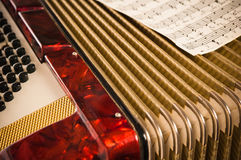 Red accordion and sheet music Stock Photo