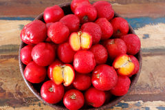 Red acerola (malpighia glabra), tropical fruit in busket. Selective focus Royalty Free Stock Photo