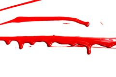 Red acrylic paint. Flows on white background stock photos
