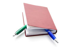Red addresses book. With two ballpoint pens Stock Photography
