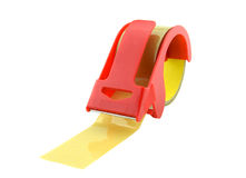 Red adhesive tape roll dispenser on white background. Stock Photography
