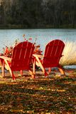 Red Adirondack Chairs. Sit in one of these Beautiful Red Adirondack Chairs Stock Photo