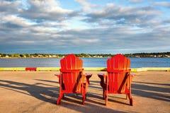 Red adirondack chairs Stock Photo