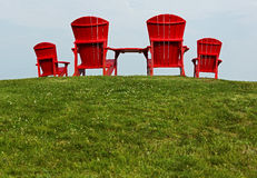 Red Adirondack Muskoka Chairs Stock Photo