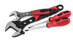 Red adjustable wrenches and screwdrivers Royalty Free Stock Photos