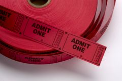 Red Admit One Tickets. Close up shot of a roll of red Admit One tickets shot on white background with soft shadow stock image