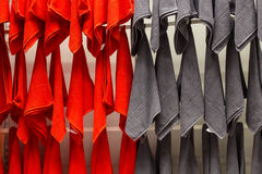Red adnd grey towels hung on the wall. With pegs Stock Photography