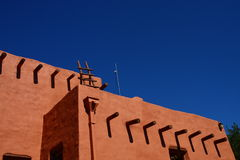Red Adobe on Blue Sky Stock Photo