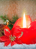 Red advent candle and snow. Royalty Free Stock Image