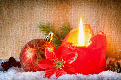 Red advent candle and snow. Royalty Free Stock Photography