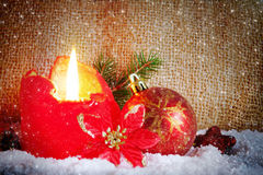 Red advent candle and snow. Stock Photo