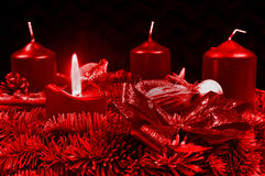 Red Advent wreath with burning candles Stock Photos