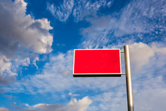 The red advertisement board against blue sky.  Stock Photo