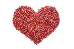 Red adzuki beans in a heart shape Stock Images