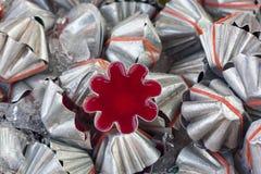 Red agar jelly in aluminium flower mold. Stock Photo