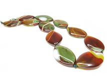 Red agate beads with green spots Royalty Free Stock Image
